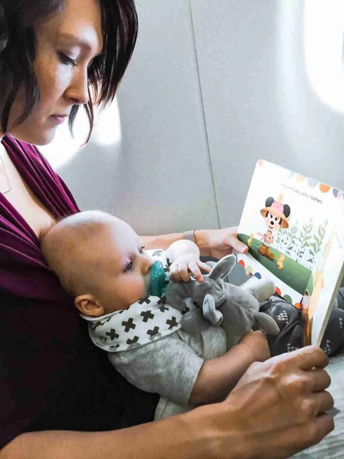 baby on mom's lap on airplane