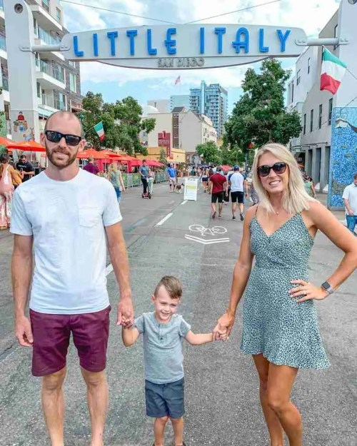 Family standing in front of Little Italy sign in San Diego