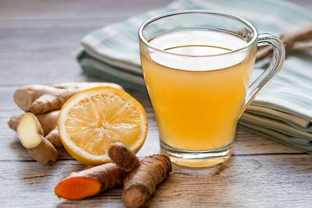 Apple cider vinegar, turmeric, and lemon juice mixed in warm water