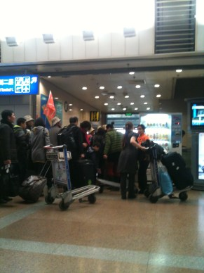 Lots of People: I watched so many people and tour groups like this one come and go in the six hour layover I had in Beijing.