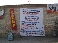 One of many banners strung up on the buildings and walls lining Taksim Square.