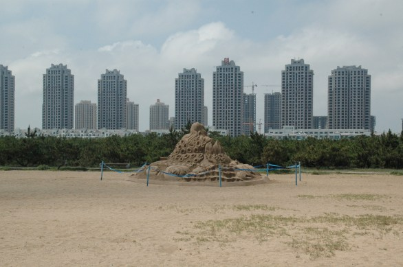 A Lone Sandcastle and Lots of Empty High Rises