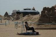 Protector of the Sandcastles and His Sleeping Sidekick