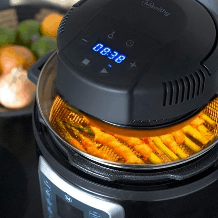 close up image of a mealthy crisp lid cooking on top of an Instant Pot.