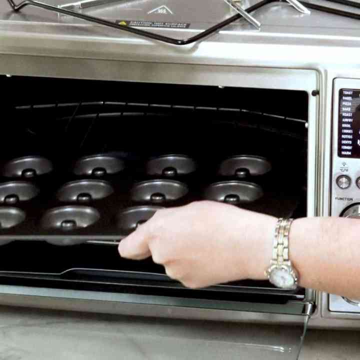 image of a donut pan being placed in the cosori air fryer oven