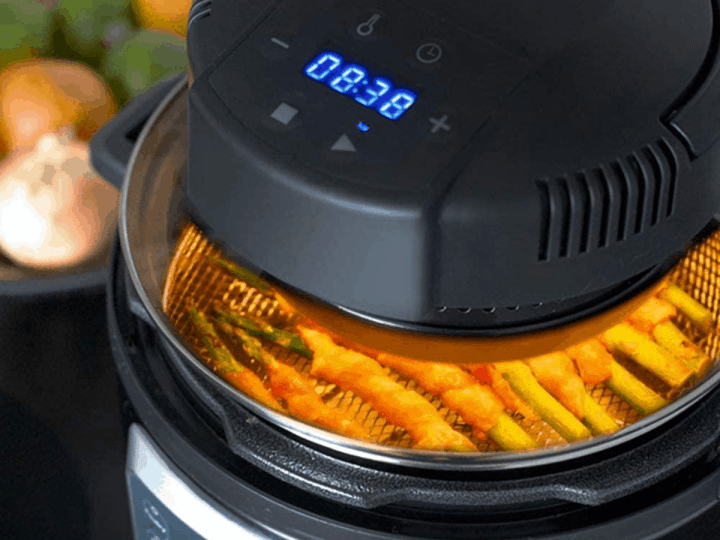 Close up image of a mealthy crisp lid air frying items in a pressure cooker.