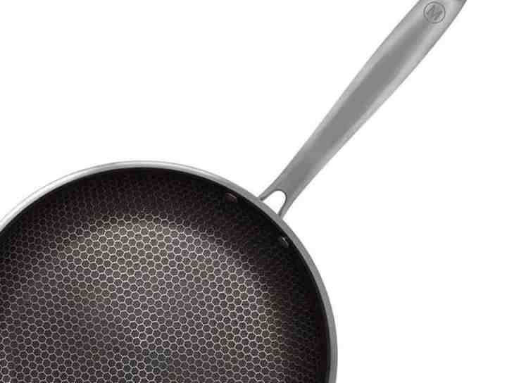 Closeup of mealthy nonstick pan to show the hexagon pattern on the pan.