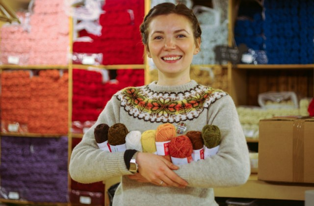 THIS WONDERFUL TEXTILE THAT WE SHOULD ALL WEAR (here is Ella Gordon at Jamieson & Smith wearing a vintage Shetland wool sweater and bearing arm fulls of tasty shades of Shetland Wool).