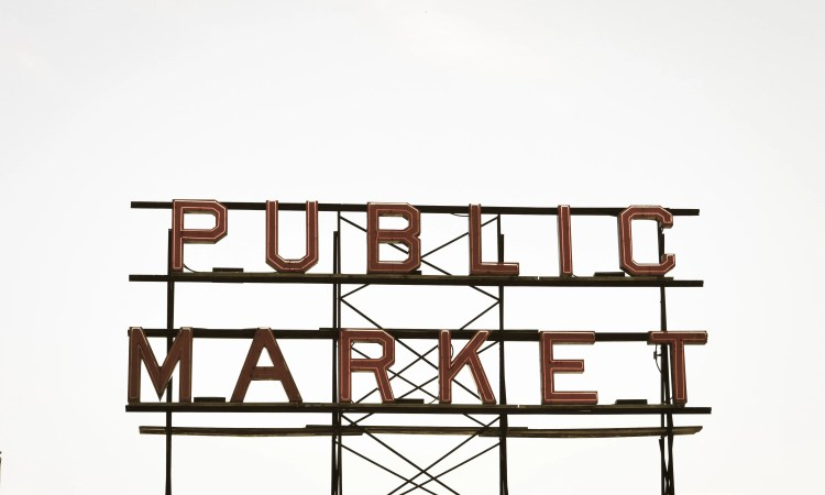 Large outdoor sign showing the words 'Public market'