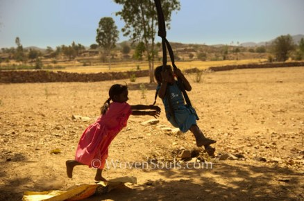 Village Children on a swing