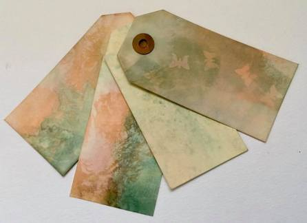 Mara Webb. A by-product of reading through Lynda Monk's latest course. Transfer dyed luggage tags. Prepared transfer paper and tags both from my stash. More results to follow, just waiting for things to dry.