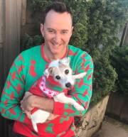 Dogs design sweaters for themselves and humans for the holiday season; yes, you read that right!