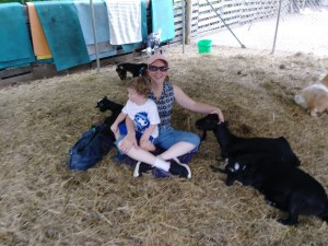 petting goat with grandson