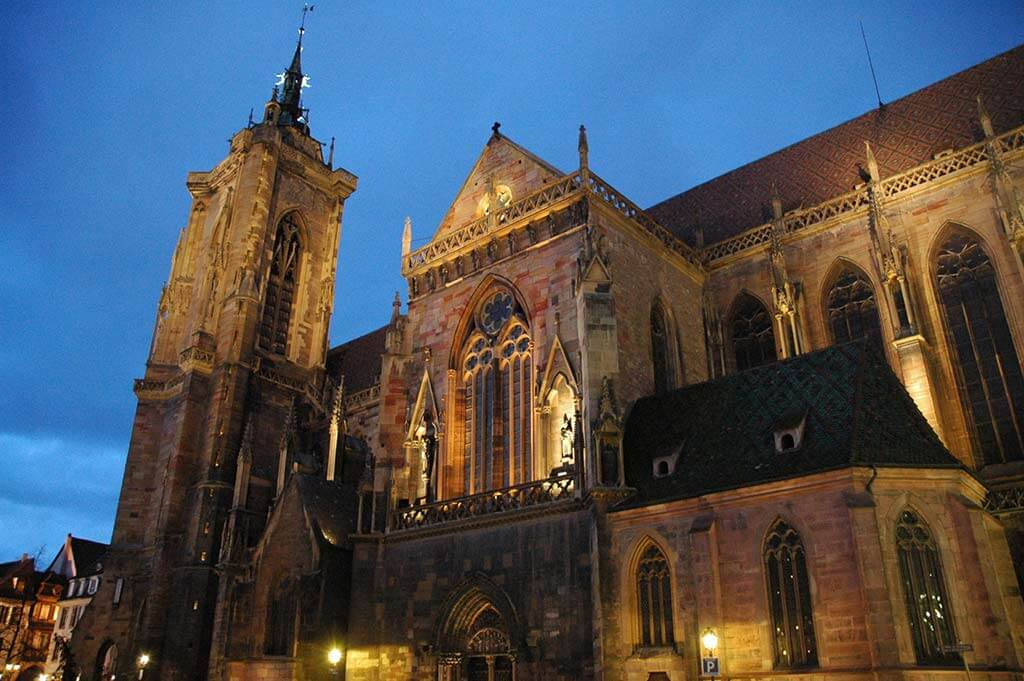 Saint Martin Collegial Church at night by Philippe Sosson/Wikipedia.org