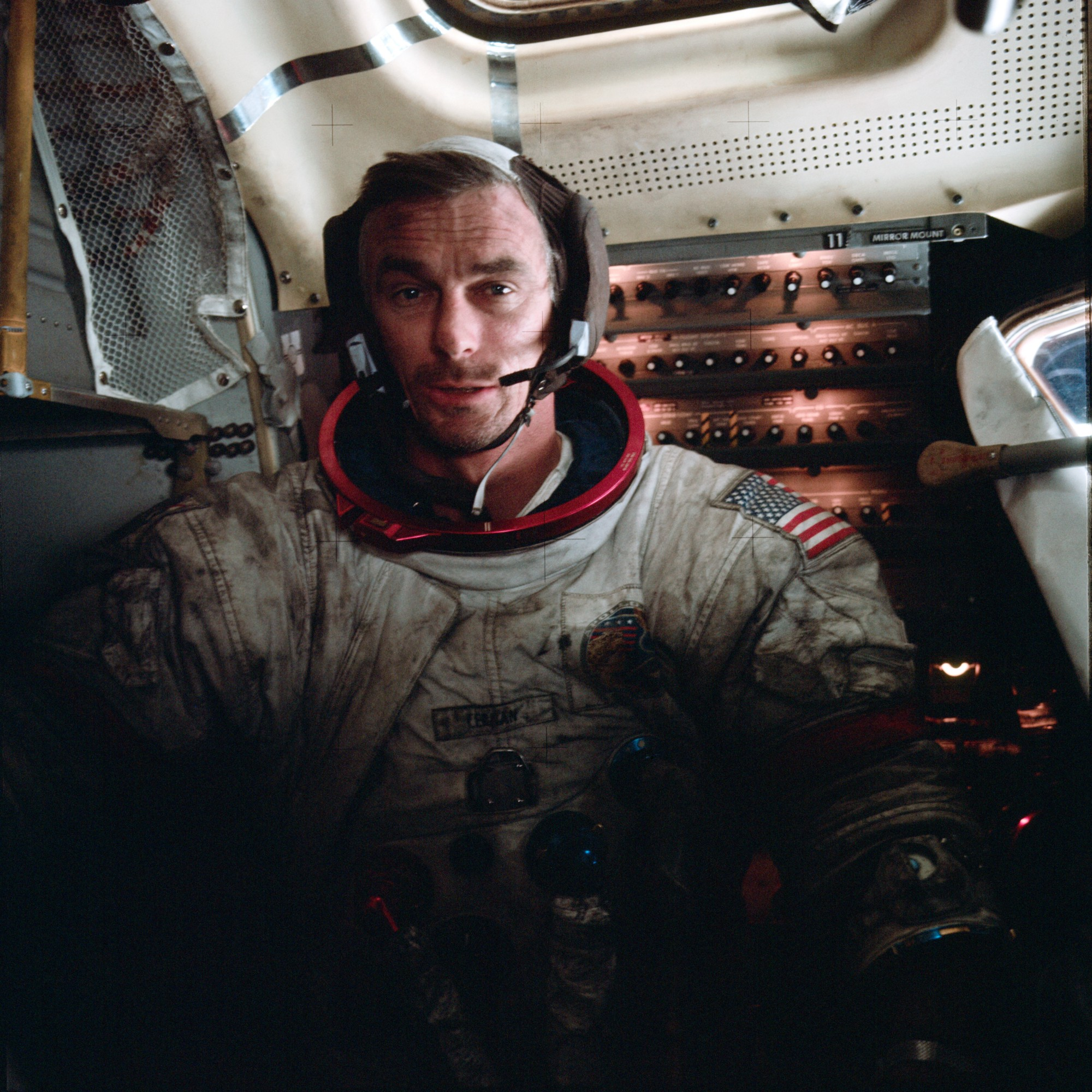 Apollo 17 astronaut Eugene Cernan covered in extraterrestrial dust, which makes his white suit look black with dirt from the waist to the shoulders.