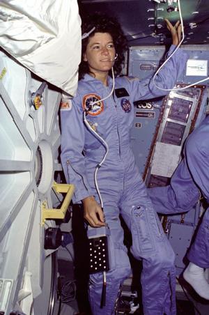 Sally Ride floats alongside Challenger's middeck airlock hatch. Image Credit: NASA