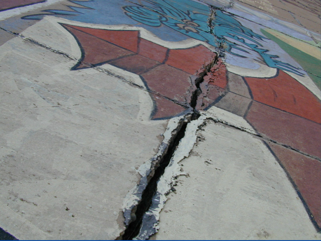 A crack is seen along Pueblo's Arkansas River levee