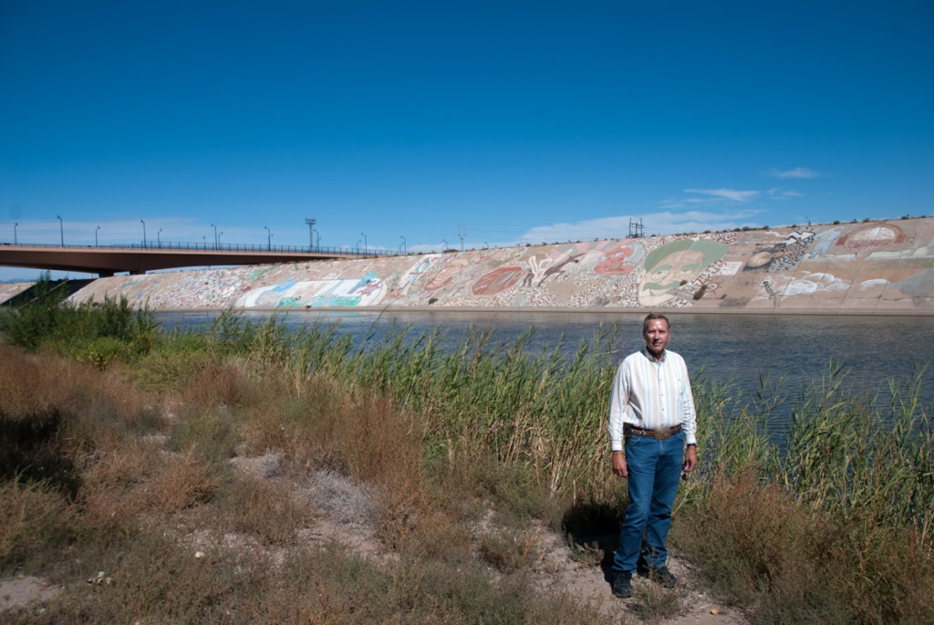 Rick Kidd of the Pueblo Conservancy District stands along the Arkansas River near the 4th Street Bridge.