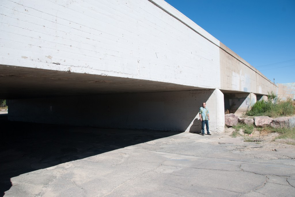 Kim Kock, the consulting engineer for the Pueblo levee project, stands beneath the 11th Street Bridge, where trucks will have to haul equipment and materials to and from work sites.