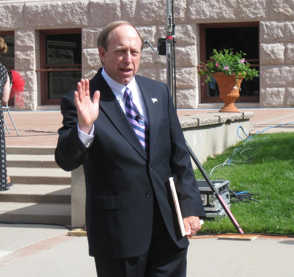 John Suthers prepares to answer questions from the media prior to taking the oath of office.