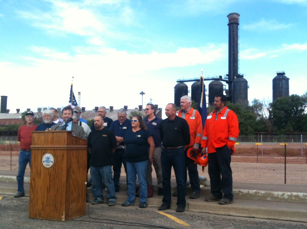 Pueblo County Commissioner and head of the state's Southwest Chief Commission Sal Pace with EVRAZ employees and union representatives