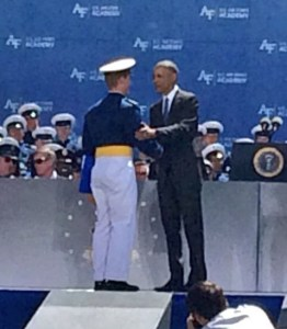 President Barack Obama, who delivered this year's commencement address at the U.S. Air Force Academy, shakes the hand of a graduate.