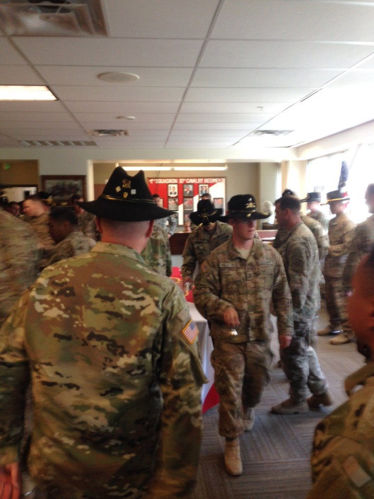 """Soldiers at Fort Carson in the 4th Squadron 10th Cavalry Regiment, one of the original Buffalo Soldier units, wear Cavalry hats for a """"Punch Ceremony."""""""