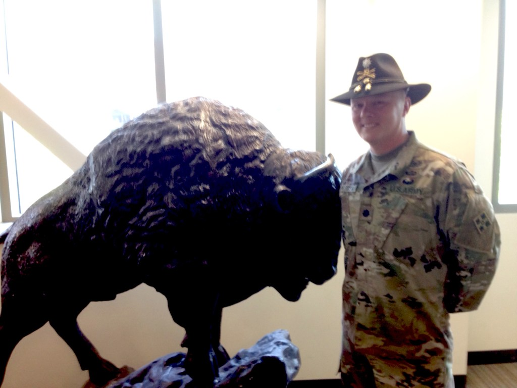 Lt. Col. Chad Foster beside a buffalo statue in the office of the 4th Squadron 10th Cavalry Regiment at Fort Carson.