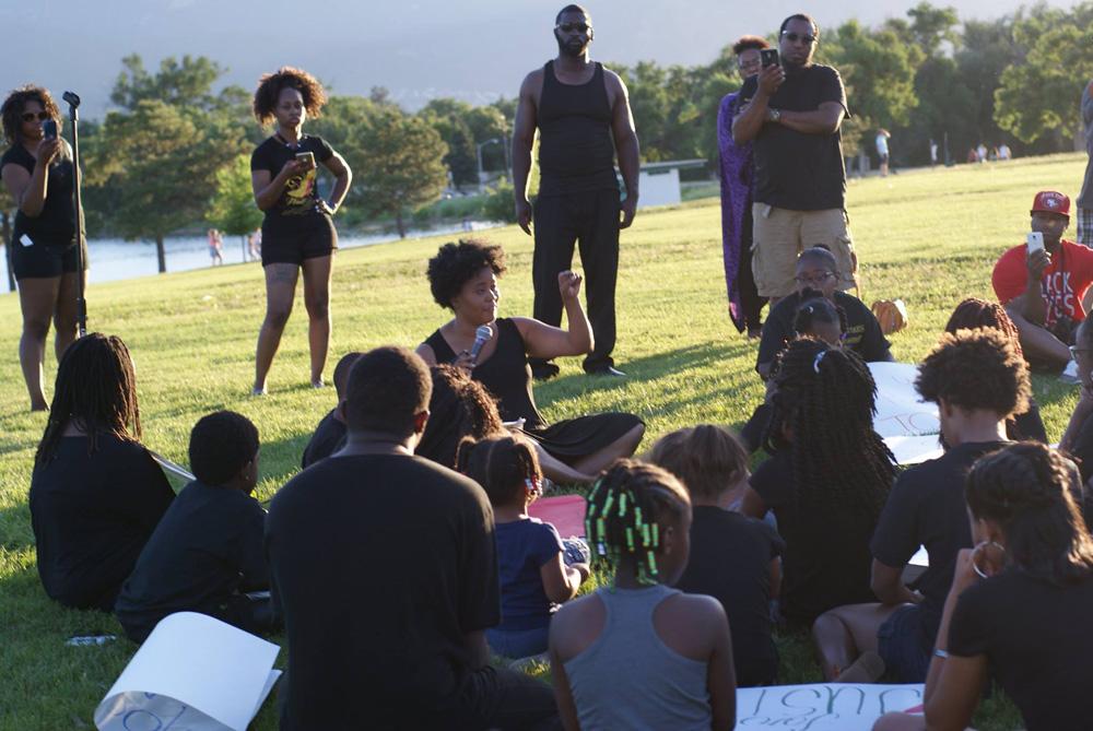 Alexis Miller, teacher, addresses children in attendance at Saturday's vigil.