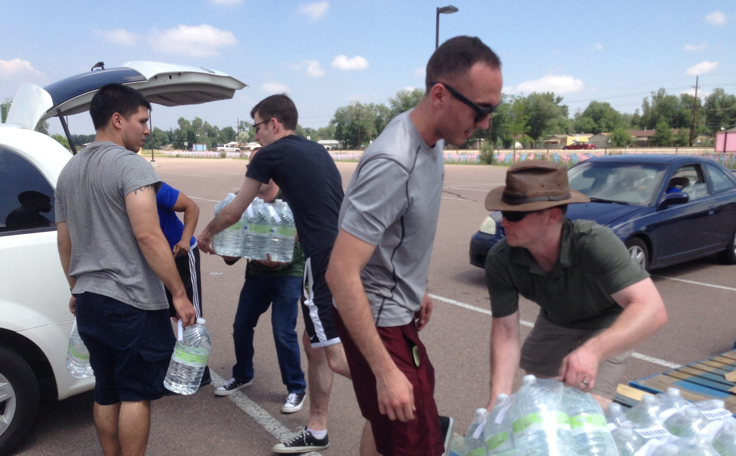Volunteers with Care and Share Food Bank distrubted free bottled water to residents of Security, Widefield, and Fountain in July.
