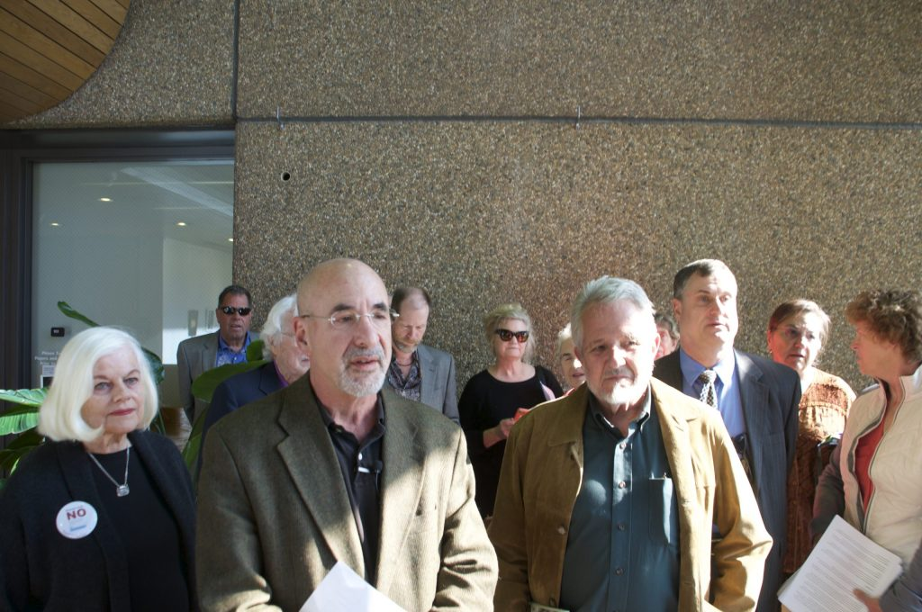 Supporters of the amendment discussed the initiative in the lobby of the city administration building.