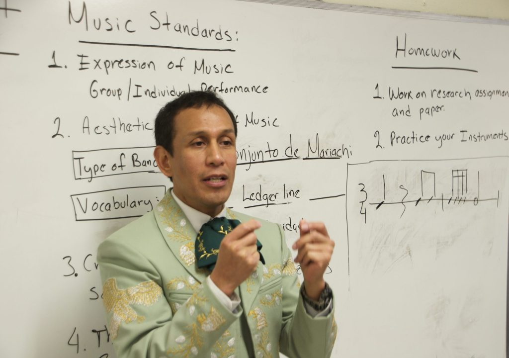 Jorge Melo, Mariachi Director at Chavez Huerta Preparatory Academy, leads his class in a syncopation exercise.