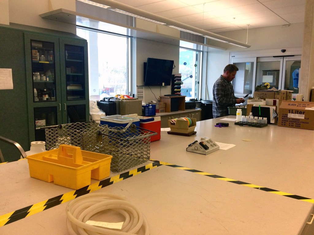 Corey Thiel readies his field equipment in his lab at a water treatment facility in Colorado Springs.