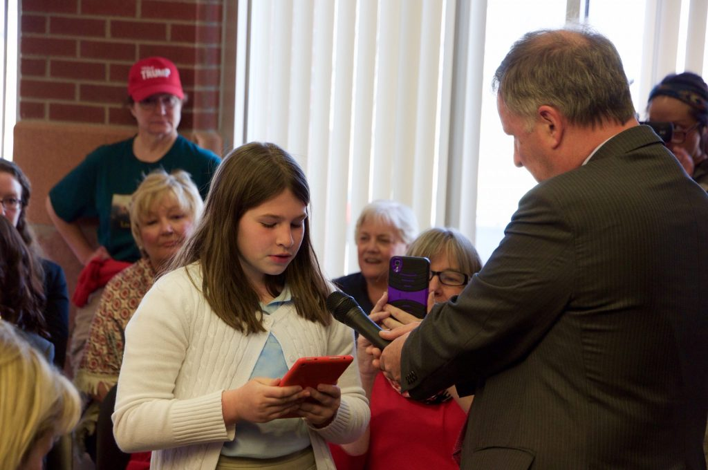 A young student reads a prepared statement, and invites Rep. Lamborn to her science class for a presentation on climate change.