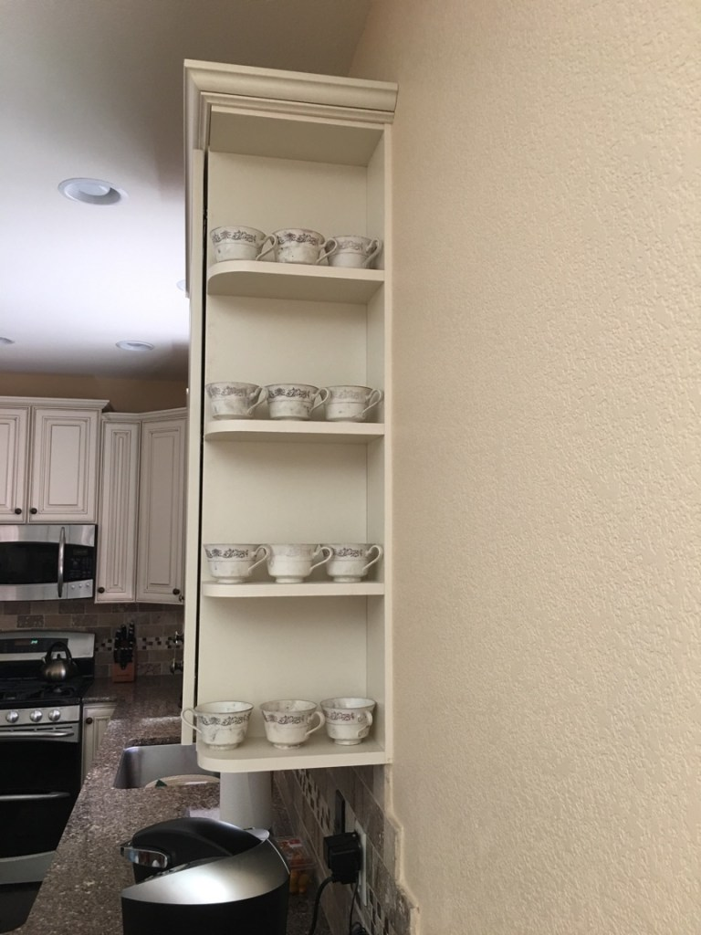 A set of porcelain tea cups was one of the few items that Myrna Candreia was able to recover from her home after the fire. They're still covered in ash.