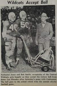 This newspaper clipping is from The Pueblo Chieftain, October 22, 1950, and the photo marks the moment when this historic football rivalry became formalized as The Bell Game. Local booster Lou Rhoades donated the beloved bell. He is pictured here with winning Wildcat players.