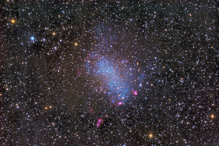 Something pink and something blue... Nearby NGC 6822, also known as Barnard's Galaxy. About 7,000 light-years across, the dwarf irregular galaxy is seen to be filled with young blue stars and mottled with the telltale pinkish hydrogen glow of star forming regions in the deep color composite image.