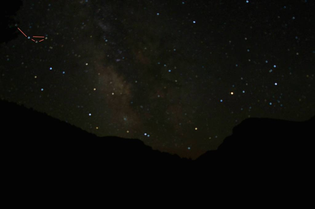 The famous tea kettle in Sagittarius and the Scorpion (Scorpius) rise over the Gates of Lodore (Dinosaur National Monument in Colorado). Look between and through those constellations on any night from late spring to early fall and you'll be looking right into the center of our galaxy.