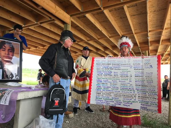 Blackfeet tribal member Theda New Breast holds up a list of all the people who went missing or were murdered on the Blackfeet Indian Reservation in Montana.