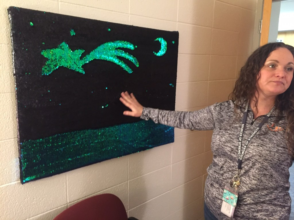 Debbie Sell showing off one of the tactile decorations in her office