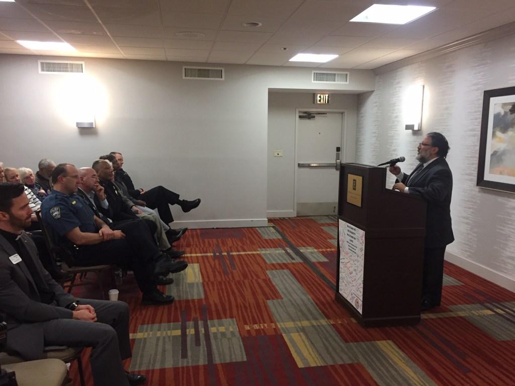 Rabbi Jay Sherwood, of Temple Shalom, speaking at the vigil