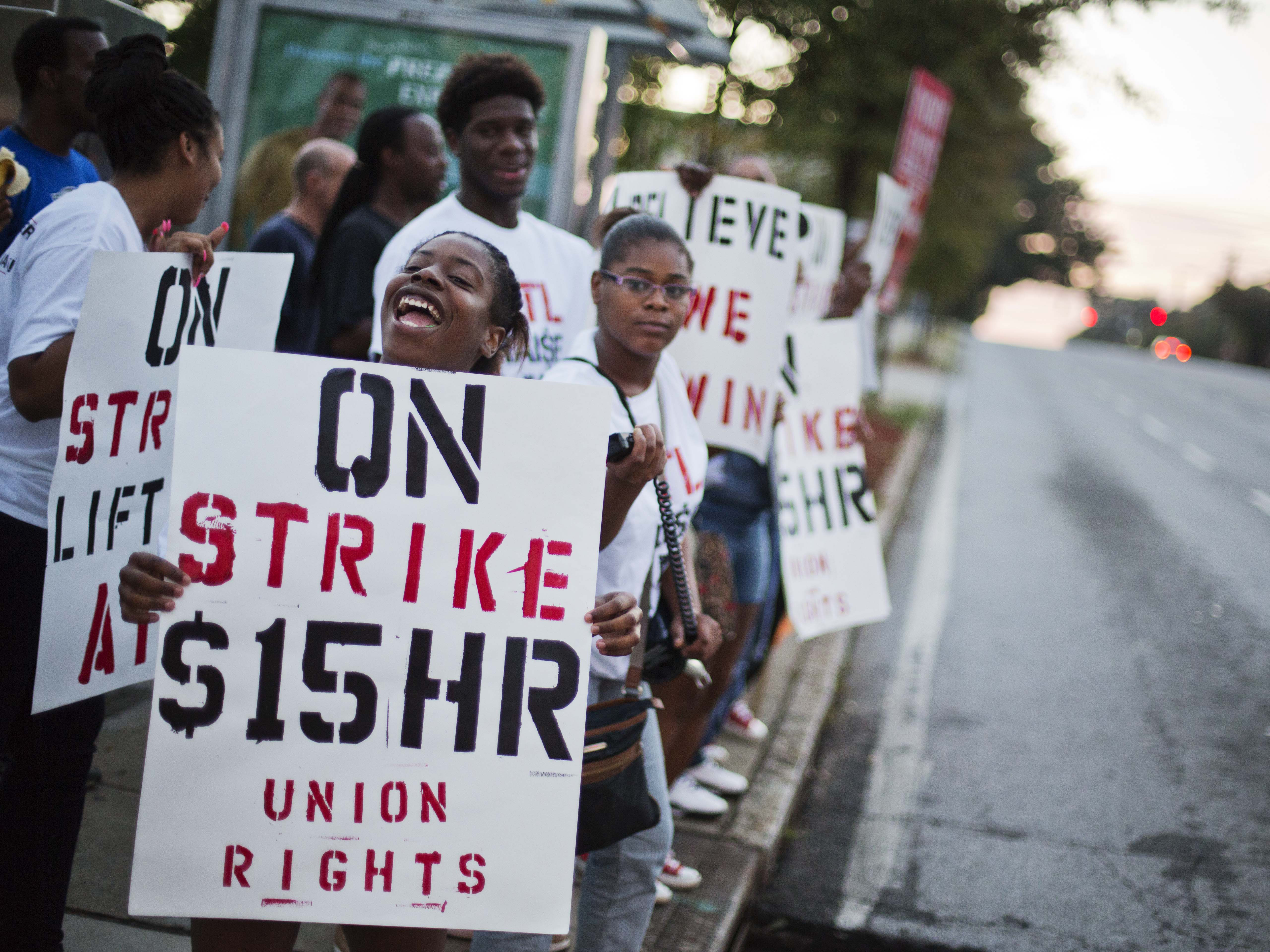 <p>Carmen Burley-Rawls, left, demonstrates outside a Burger King restaurant, Thursday, Sept. 4, 2014, in Atlanta. Calling for higher pay and the right to form a union without retaliation, fast-food chain workers across the country, including Denver, protested Thursday.</p>