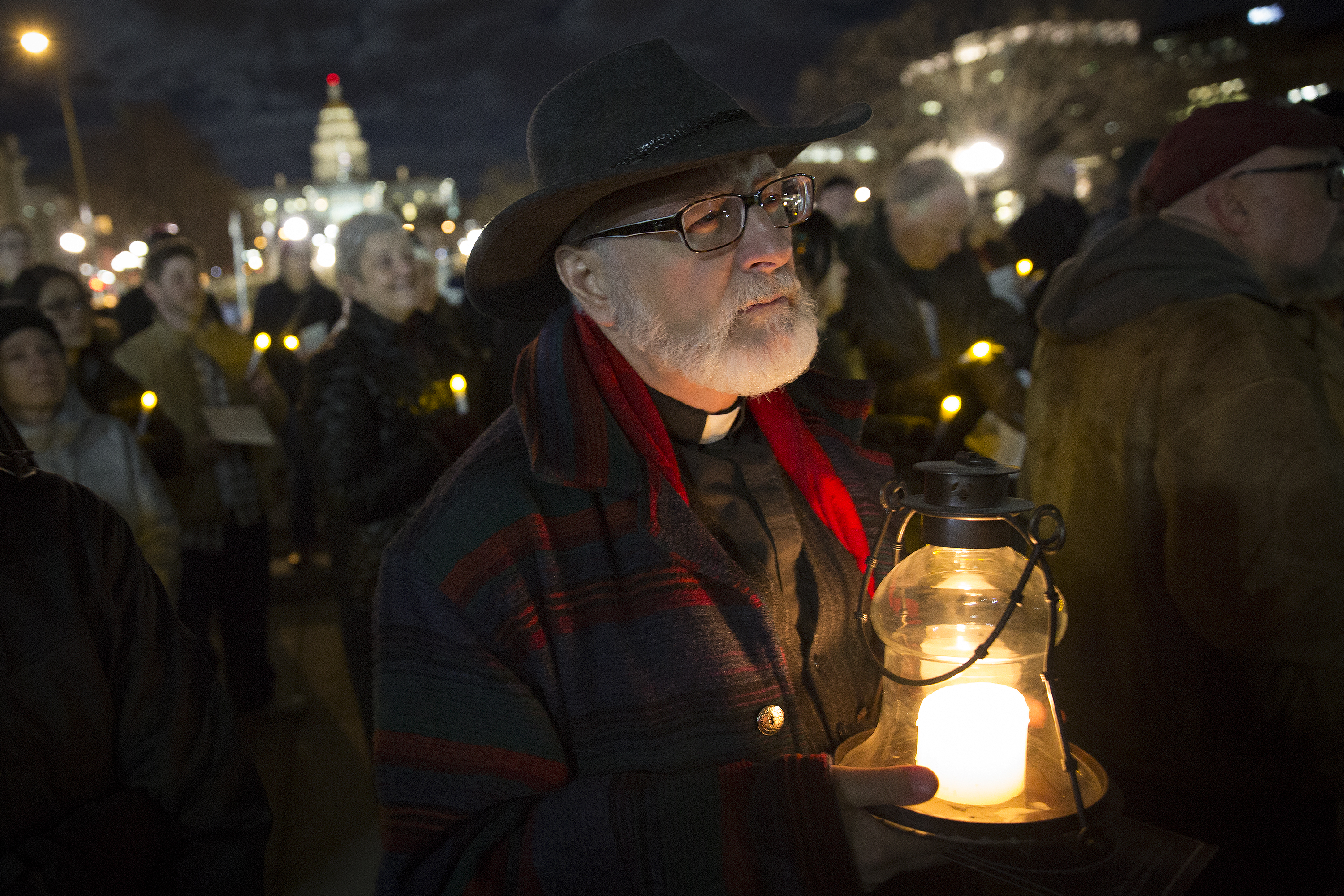 <p>Father Michael J. Nicosia, vicar to the Rocky Mountain region of the Ecumenical Catholic Communion, holds a lantern while taking part in thethe 29th Homeless Person's Memorial Vigil at the City and County building in Denver Friday Dec. 21, 2018.</p>  <p></p>