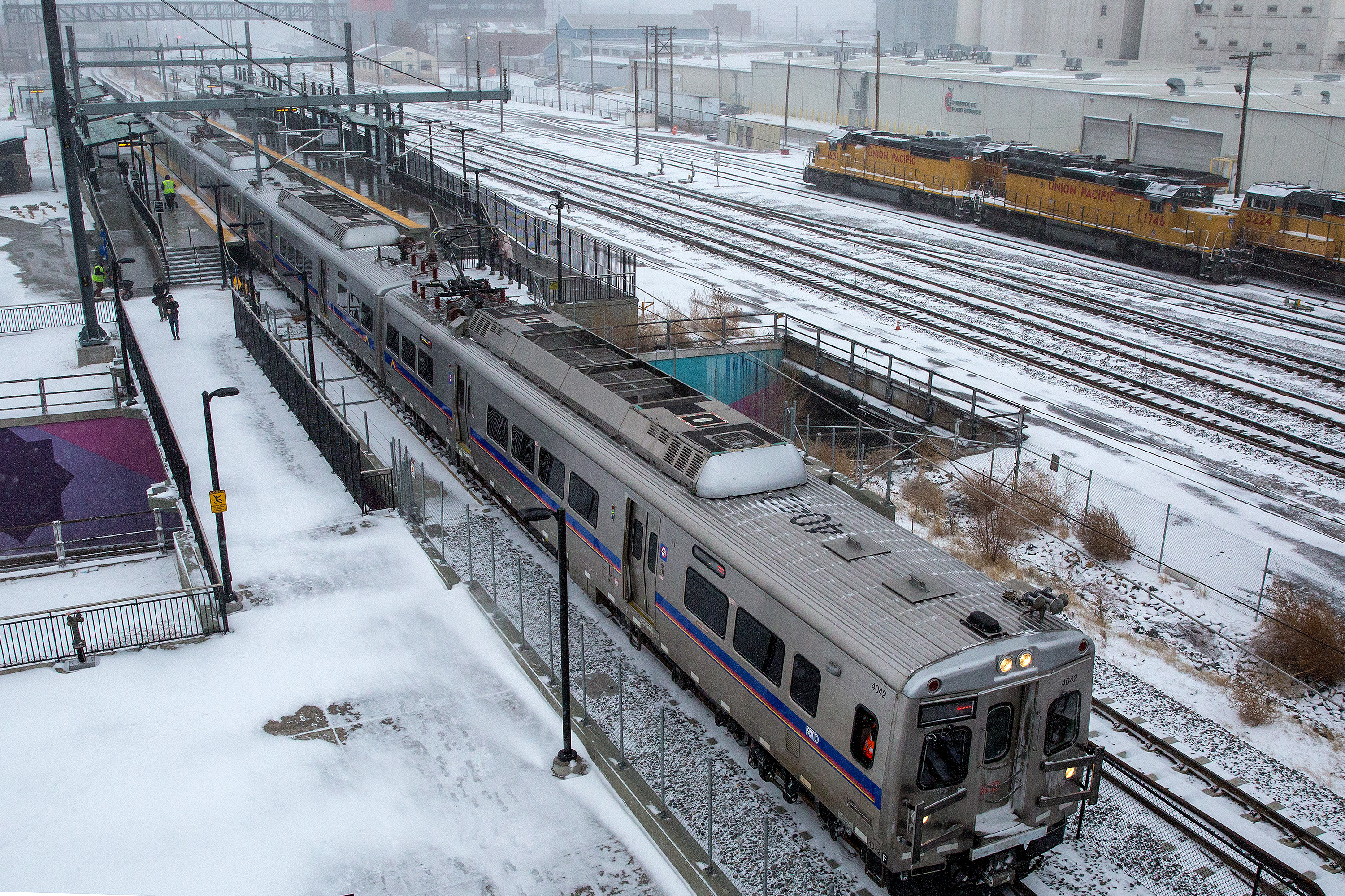 """<p class=""""normal"""">An RTD A Linecommuter rail trainat the38thand Blake Street station in Denver.</p>"""