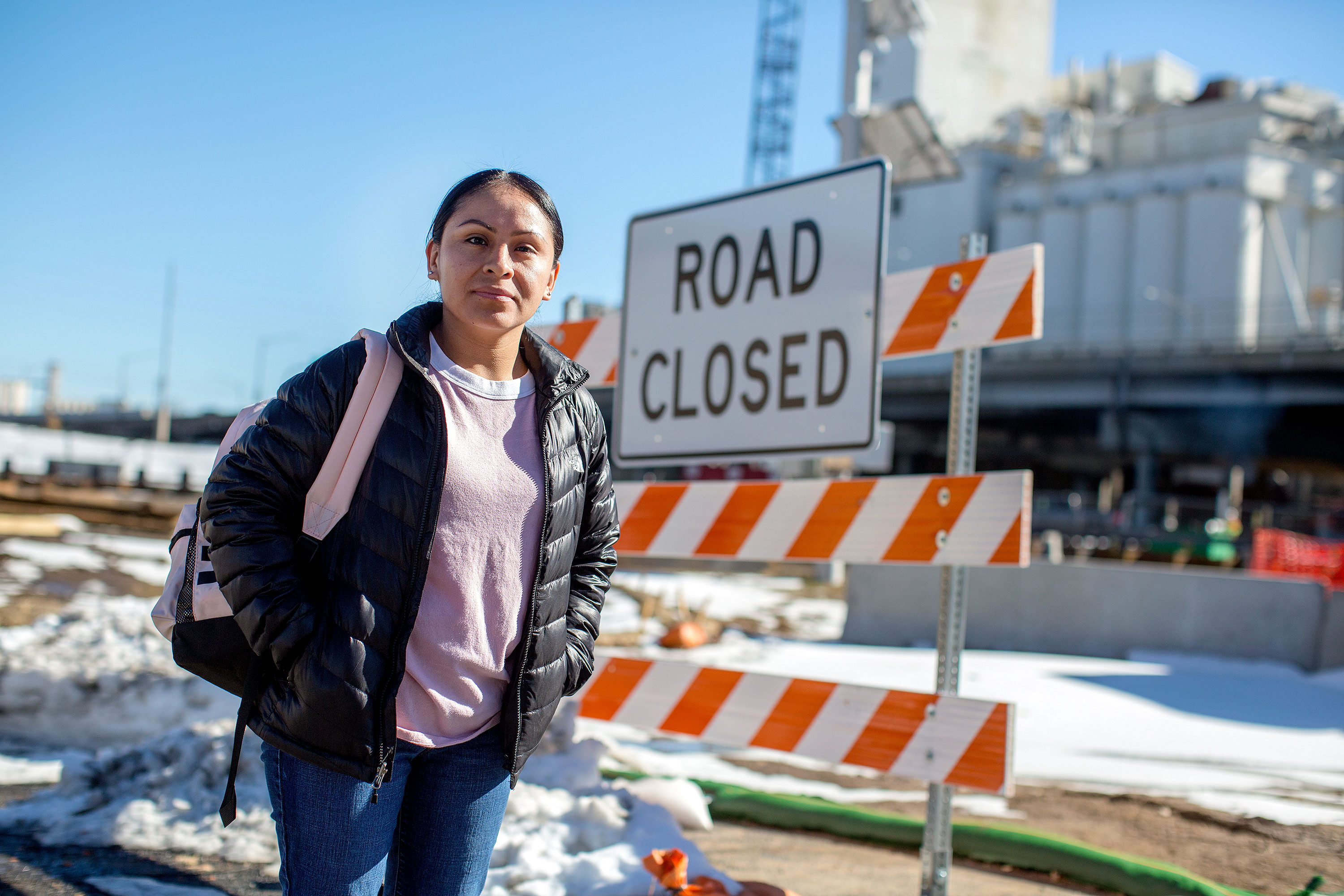 <p>Gabby Acevedo, a member of the Globeville, Elyria-Swansea Coalition, stands near the construction for the Central 70 project that disrupted lives in the neighborhood. She was brought to the U.S. as a child, and has lived in the area for more than 10 years.</p>