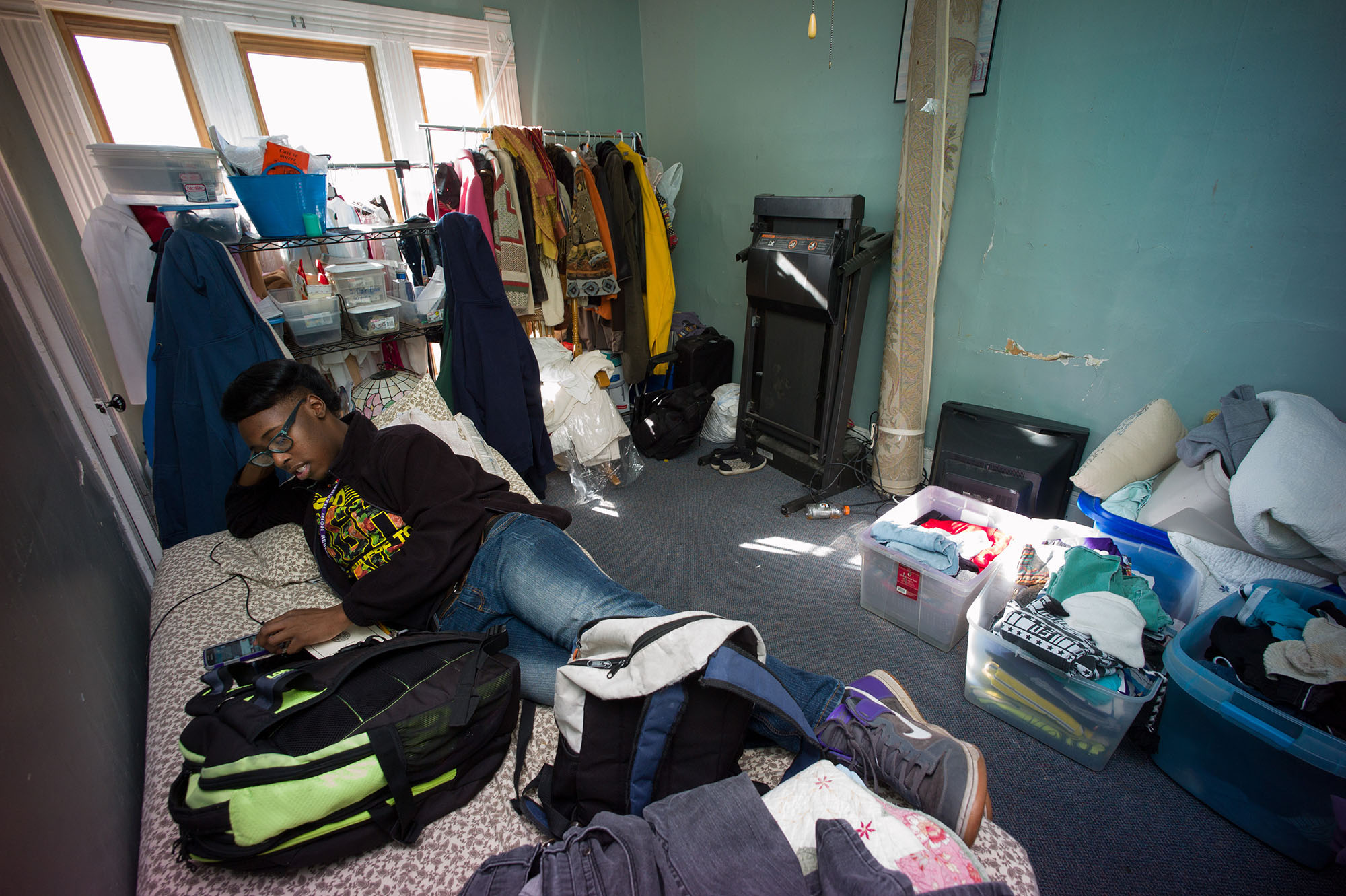 <p>Chaunsae Dyson ina bedroom cluttered with his grandmother's belongings.</p>