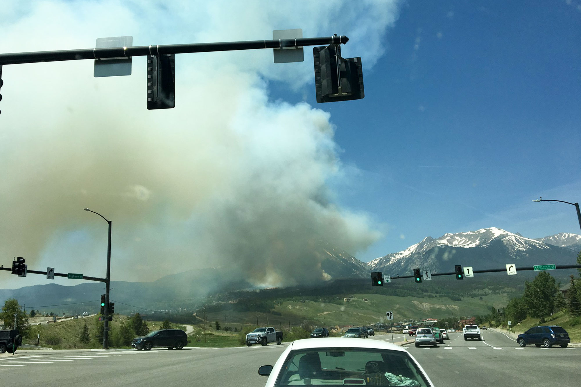 <p>Smoke hanging over the Buffalo Mountain Fire as seen from the intersection of Highway 6 and Dillon Dam Road, June 12, 2018.</p>