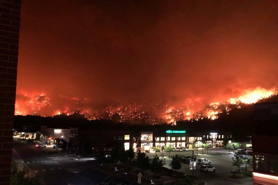 """<p>The western edge of the Lake Christine Fire, near the Whole Foods Market in Basalt. Highway 82, not seen, is just behind the grocery story in the darkness.<span style=""""color: rgb(64, 69, 64);"""">July 4, 2018</span></p>"""