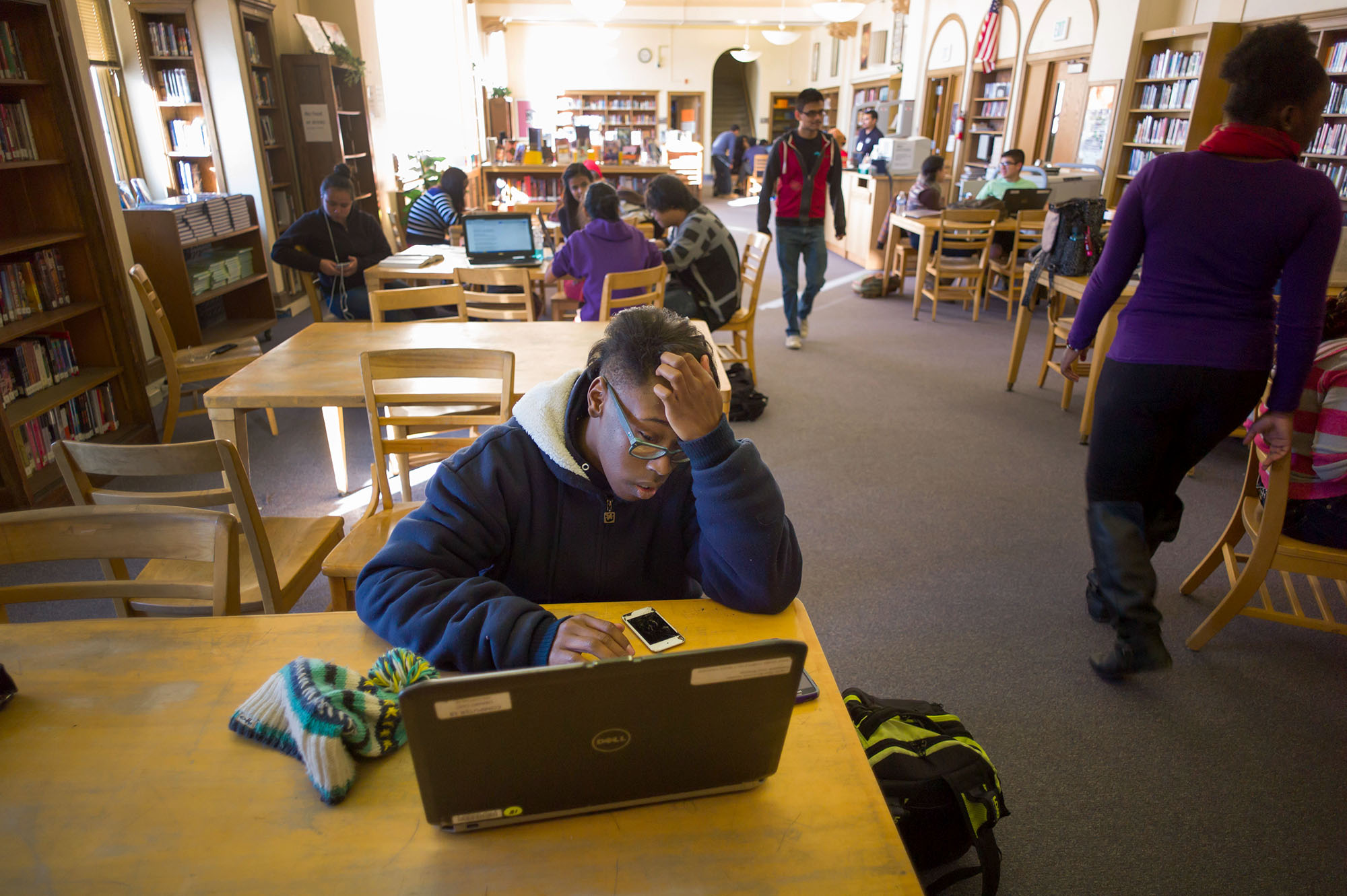 <p>Chaunse Dyson fills out online university applications in the library at South High School in Denver on Thursday, Jan. 22, 2015.</p>