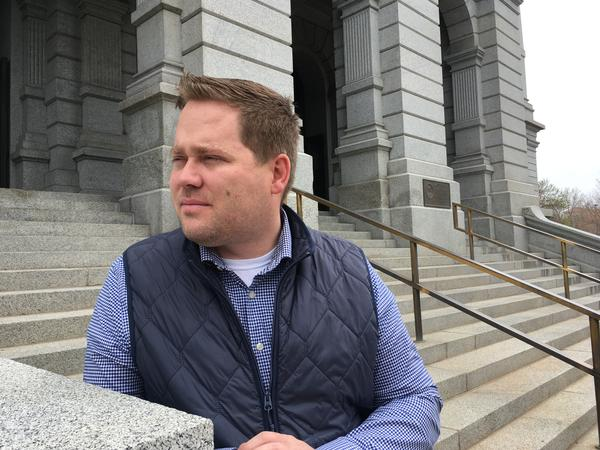 Kyle Mullica, a state representative in Colorado, stands on the steps of the state capitol building in Denver the week after his vaccination bill died.